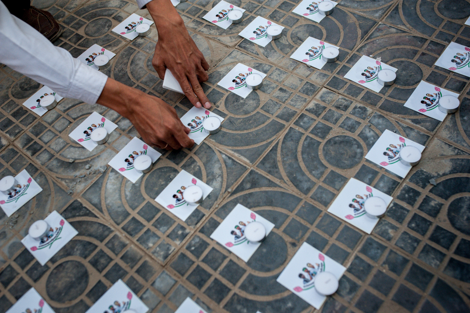 """February 1, 2014 - Phnom Penh. Candles and stickers are arranged to spell """"Free 23"""", in support of the six dead and 23 detainees resulting from deadly clashes early in January. © Luc Forsyth / Ruom"""