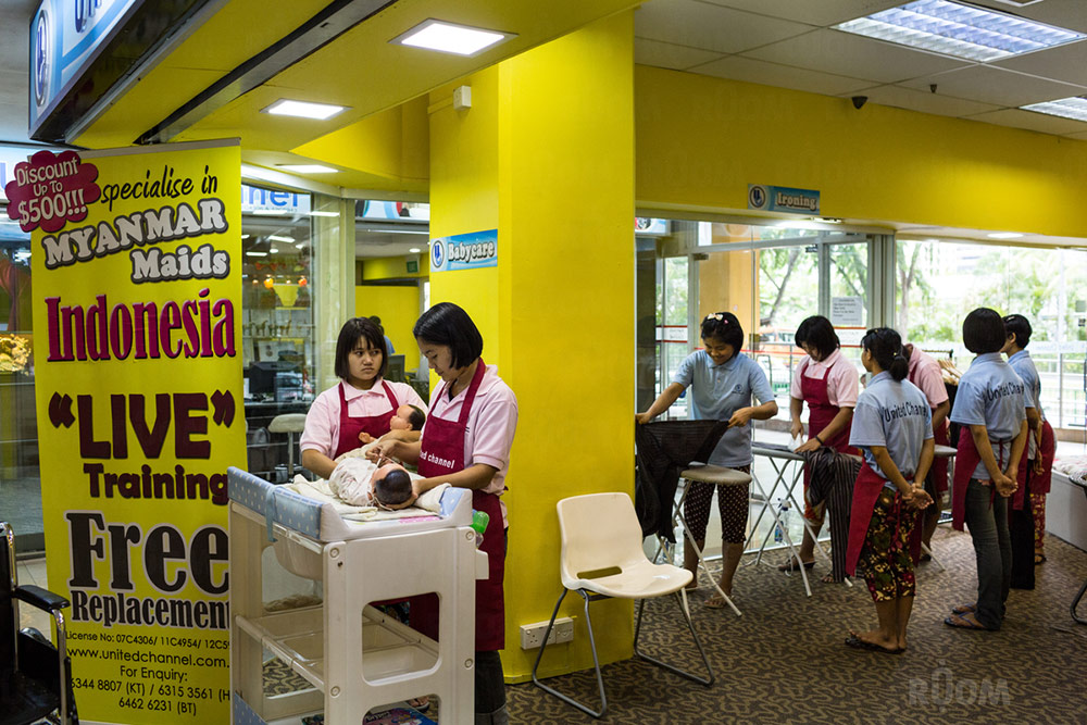 May 12, 2014 - Singapore. Maid agency with domestic workers on display at Katong shopping centre. © Nicolas Axelrod / Ruom