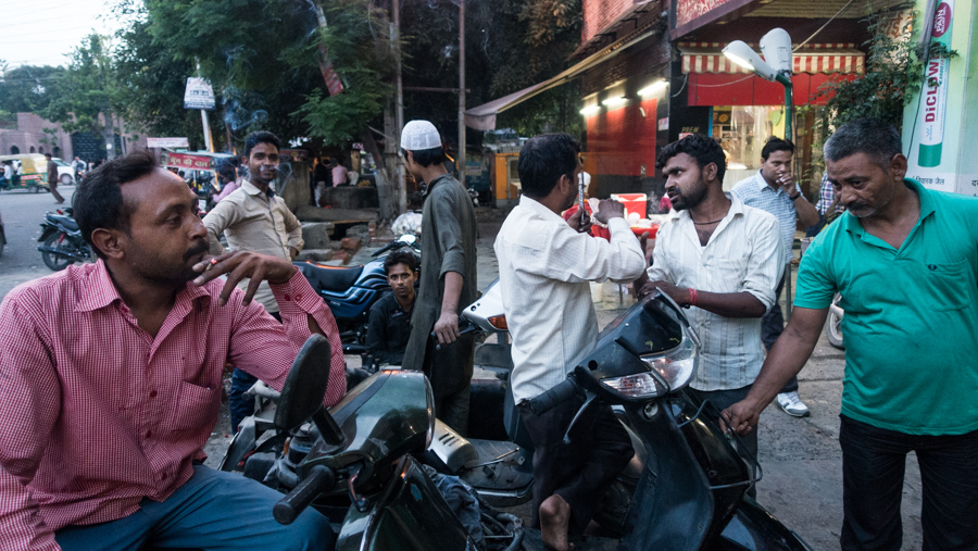 July 18, 2016 - Moradabad, India. Repairing motorcycles out the front of a shopping complex. © Nicolas Axelrod / Ruom