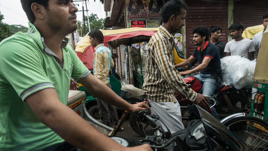 July 22, 2016 - Moradabad, India. People in traffic, photographed from a passing car. © Nicolas Axelrod / Ruom