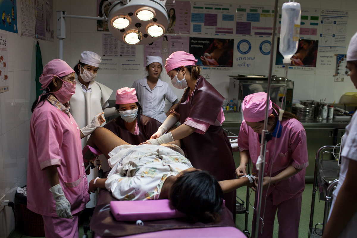 April 04, 2013 - Stung Treng, Cambodia. Midwives prepare a woman to deliver a baby. © Nicolas Axelrod / Ruom