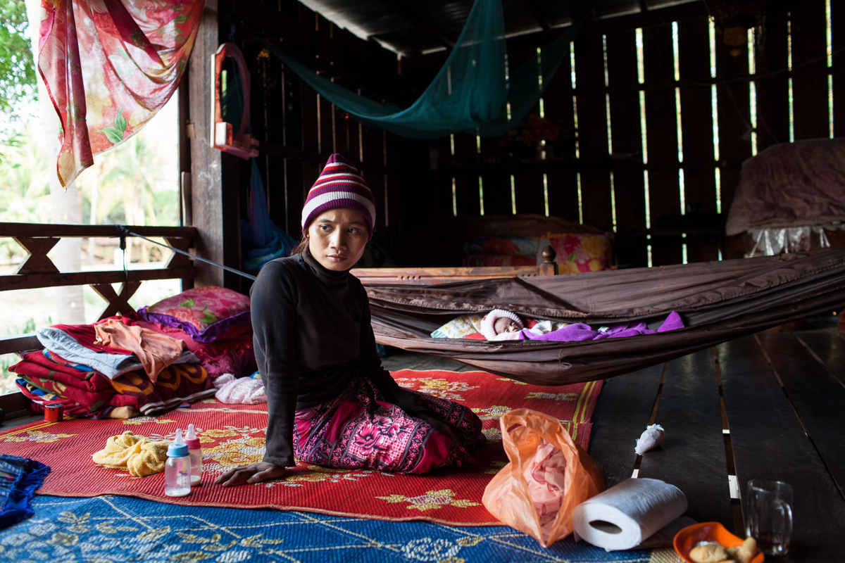 April 04, 2013 - Stung Treng, Cambodia. A young mother suffering from post-natal depression sits in her home. © Nicolas Axelrod / Ruom