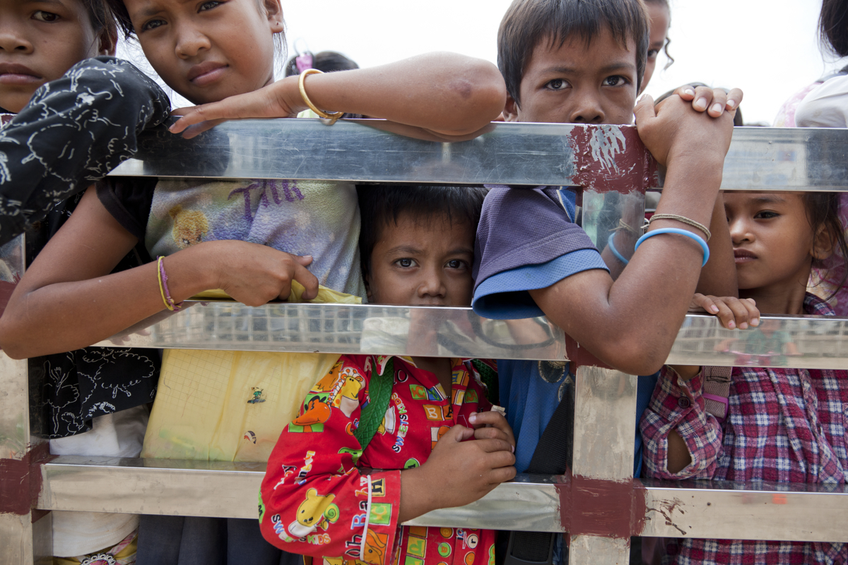 Children are driven home after school in front of the Goutte d'Eau drop in centre, Poipet, Cambodia.