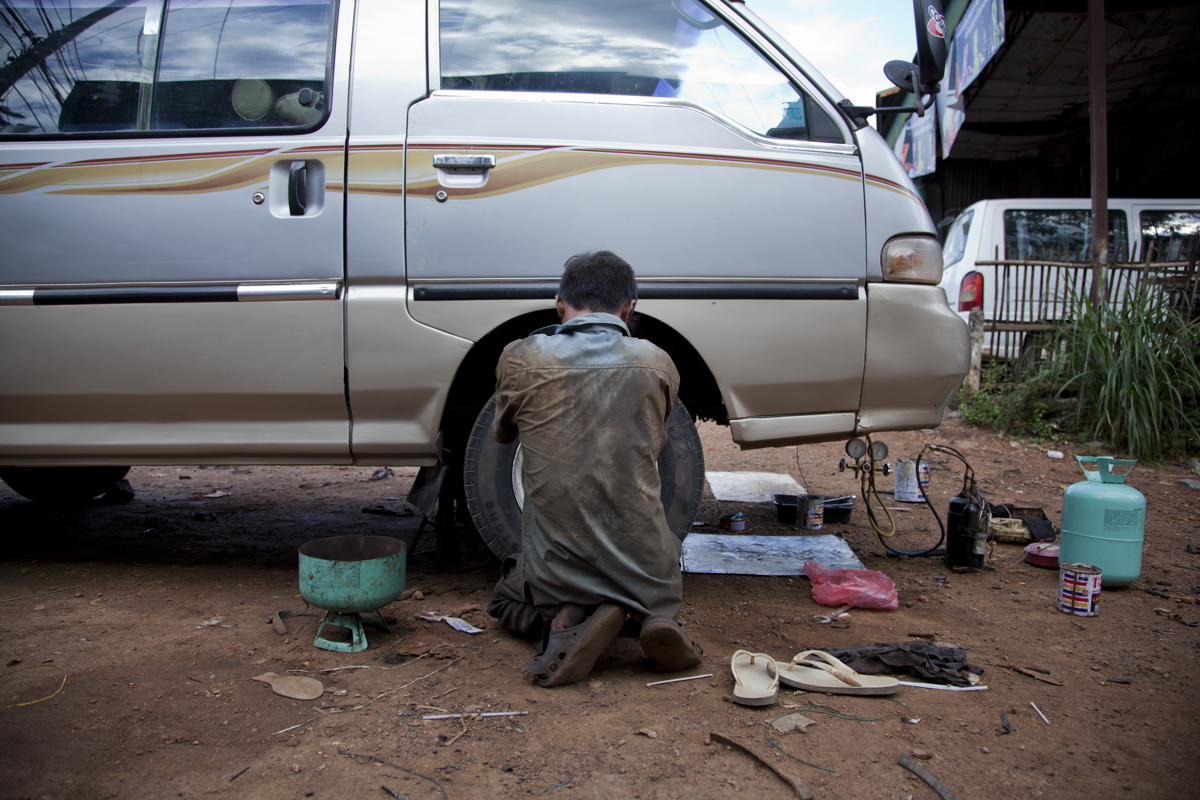 Chhem Den (16) works at the Cheng Cheun Garage in Battambang. After being released from prison for theft Den, with the help of the intervention diversion process is learning to be a mechanic.