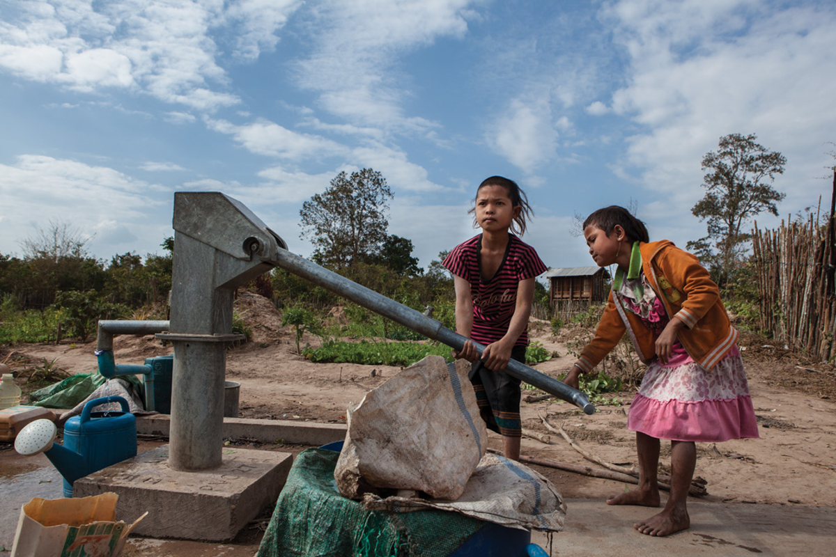 Jan. 18, 2013 - Savannakhet province, Laos. Children fill water containers at a well in Phone Marunee. � Nicolas Axelrod for HI