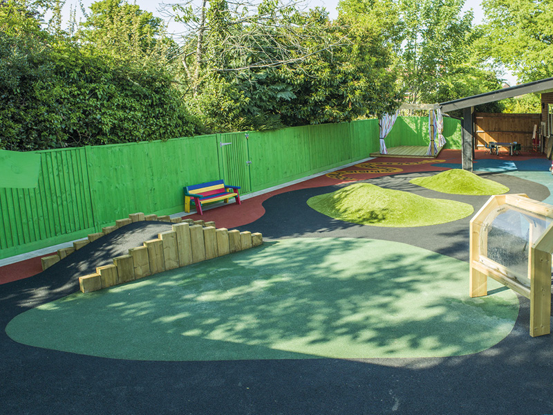 This green fence adds a fun splash of colour in this interactive play area