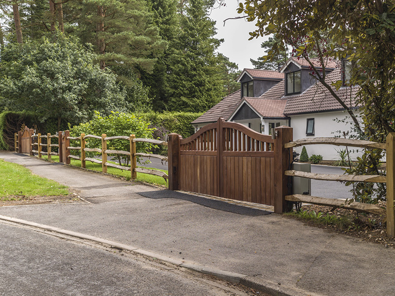 Automated gates and open fencing create a pleasing entrance to this property