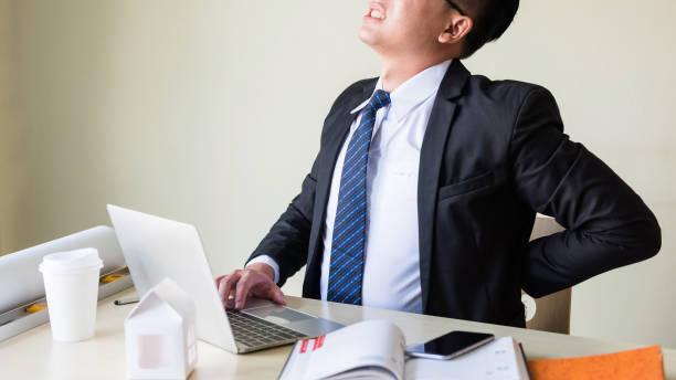 Man Back Pain Desk.jpg