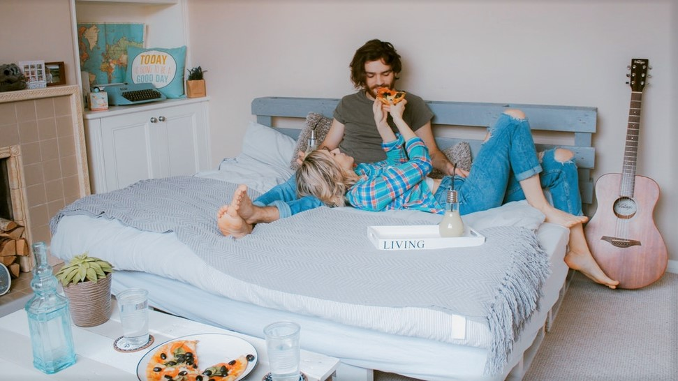 unsplash_couple eating in bed.jpg