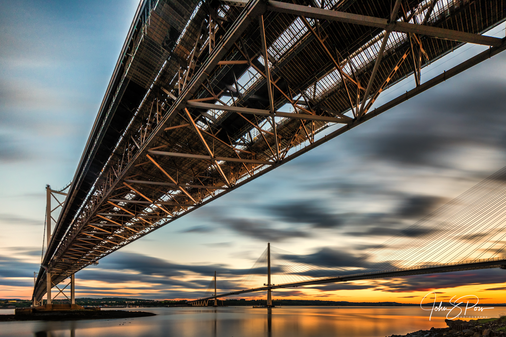 A different perspective of the Forth Road Bridge with the Queensferry Crossing.