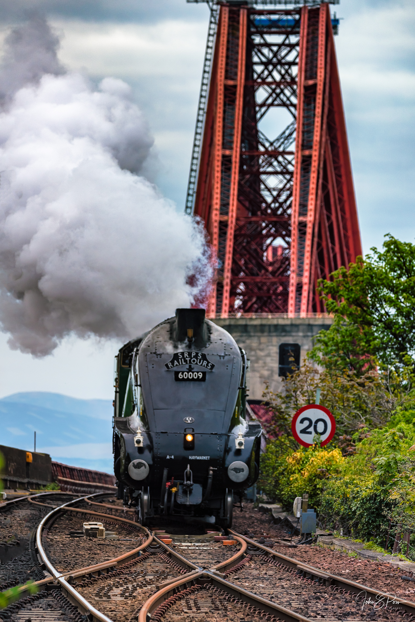 The Union of South Africa steam into Fife at North Queensferry with the Forth Bridge in the background.