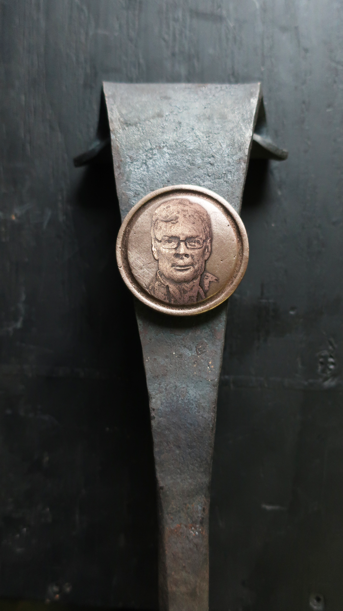 An example of the cast bronze medallions
