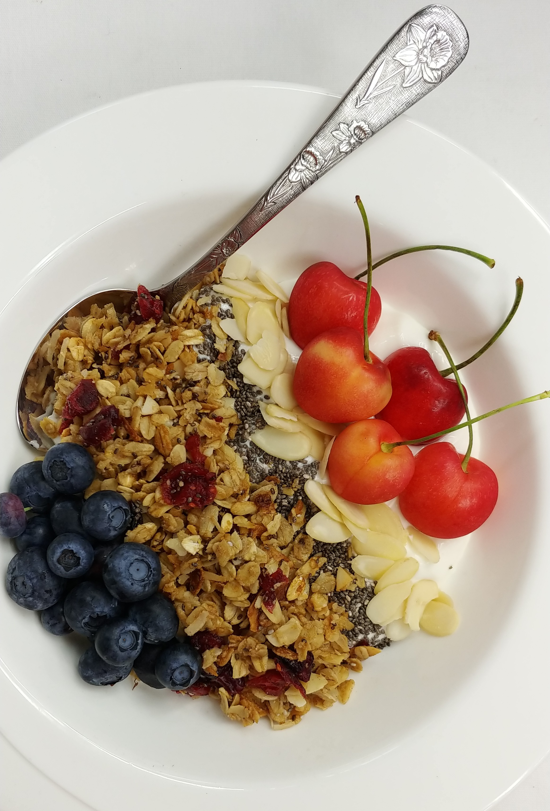 Liberty Tabletop's floral pattern flatware goes perfectly with my yogurt and granola breakfast bowl!