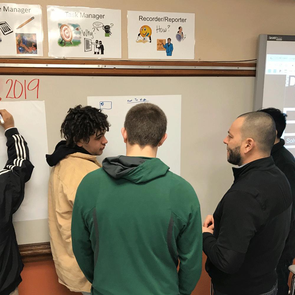 Salem-Keizer students brainstorm with an OMESC volunteer