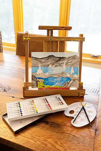 Watercolor Painting on Easel with Paints and Brushes.jpg