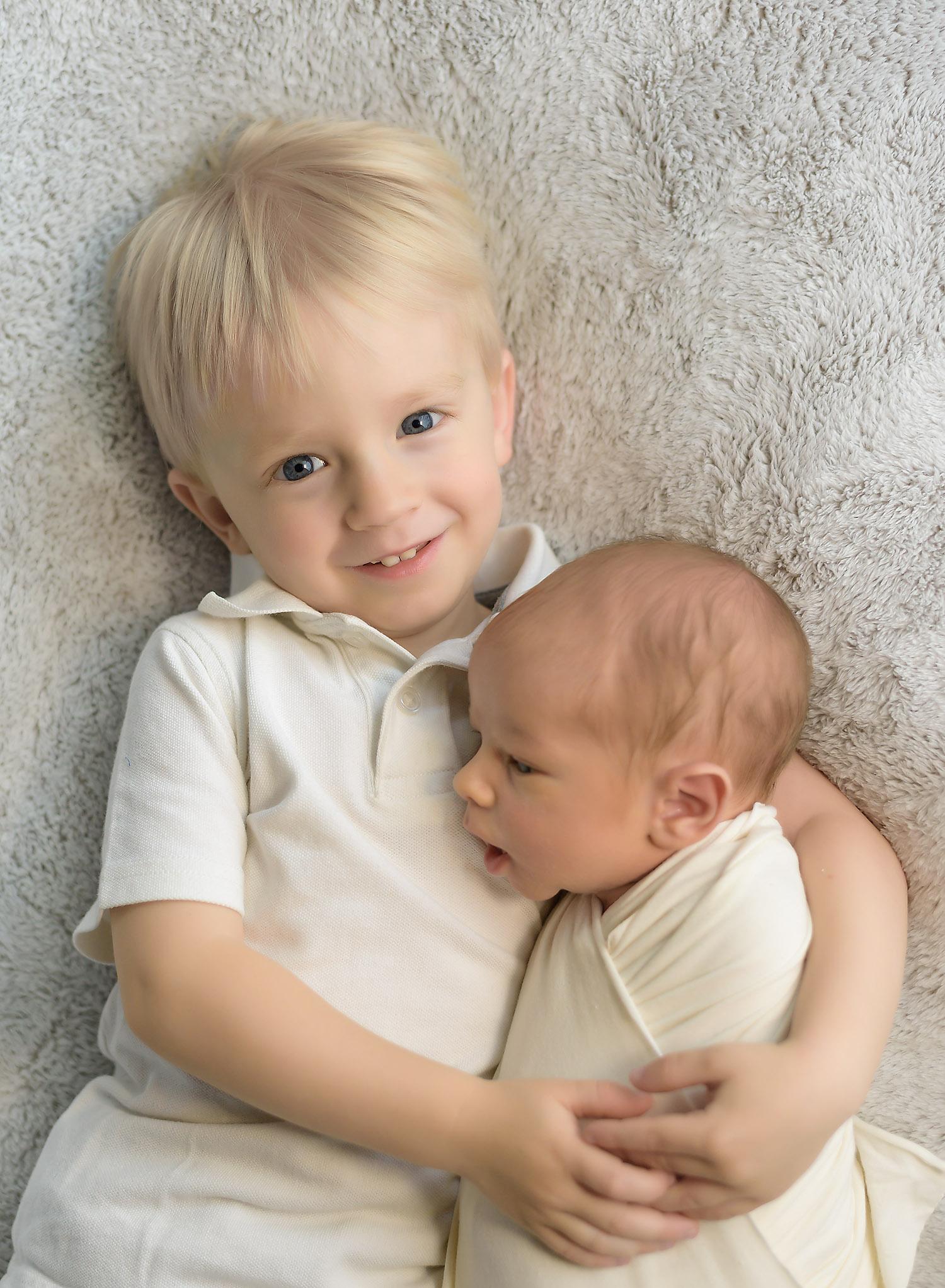 Newborn with Big Brother.jpg
