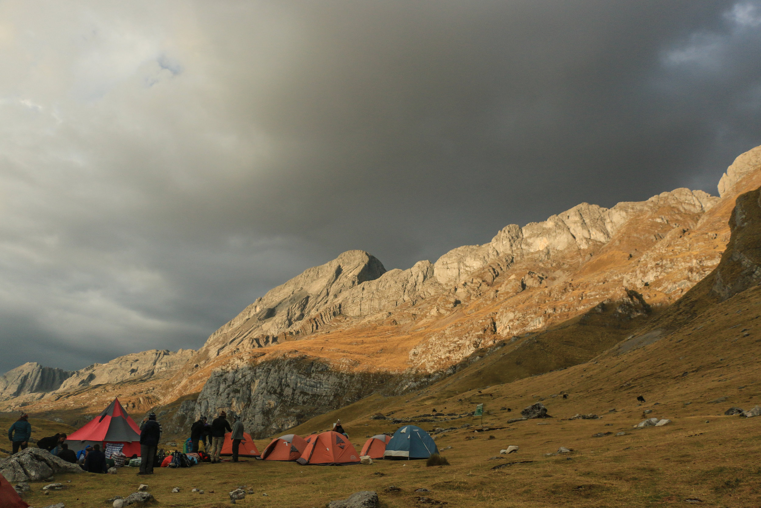 Rain clouds gathering above a neighboring camp.