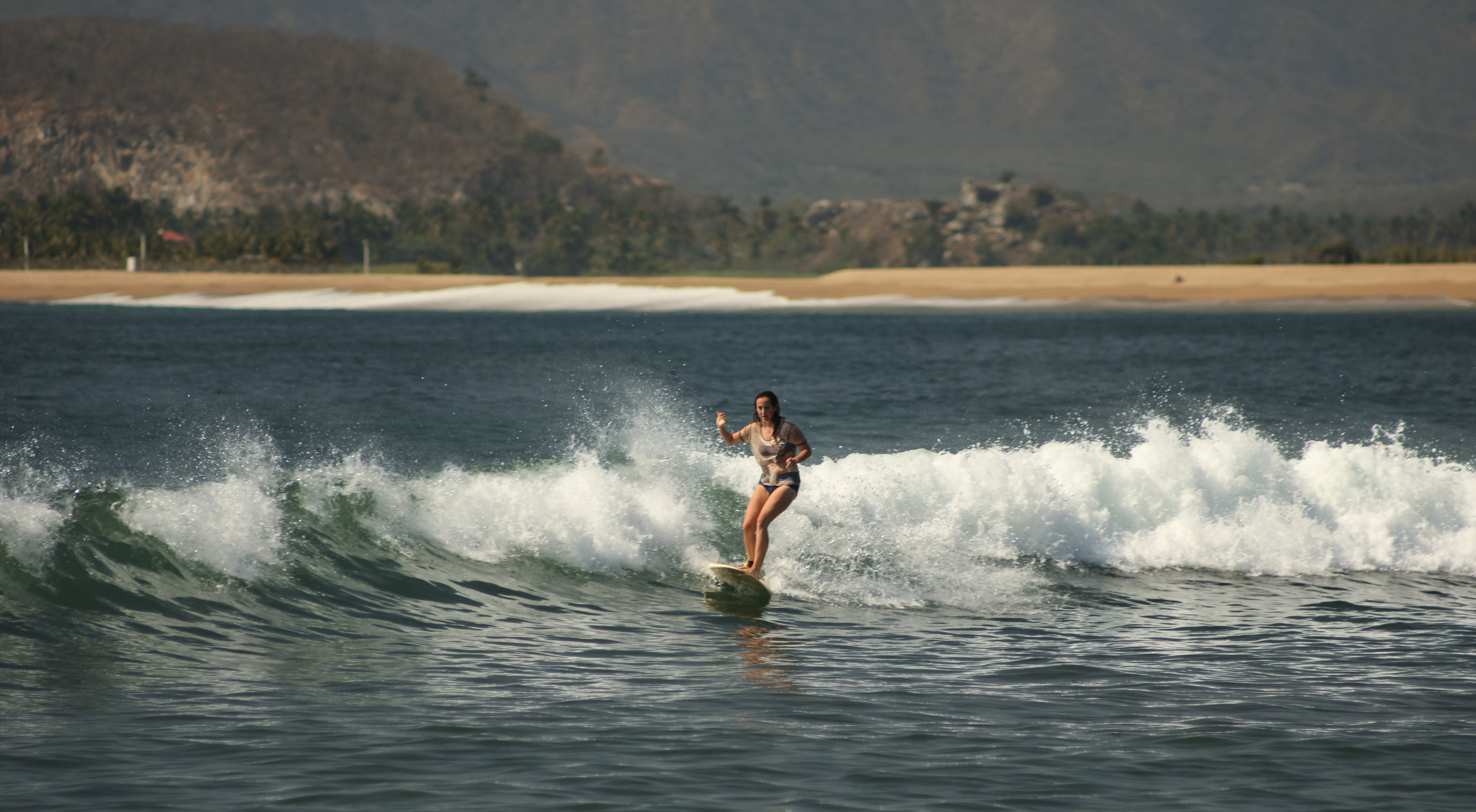 Rachel's best friend Carly came down for a visit. Here she is shredding some baby waves.