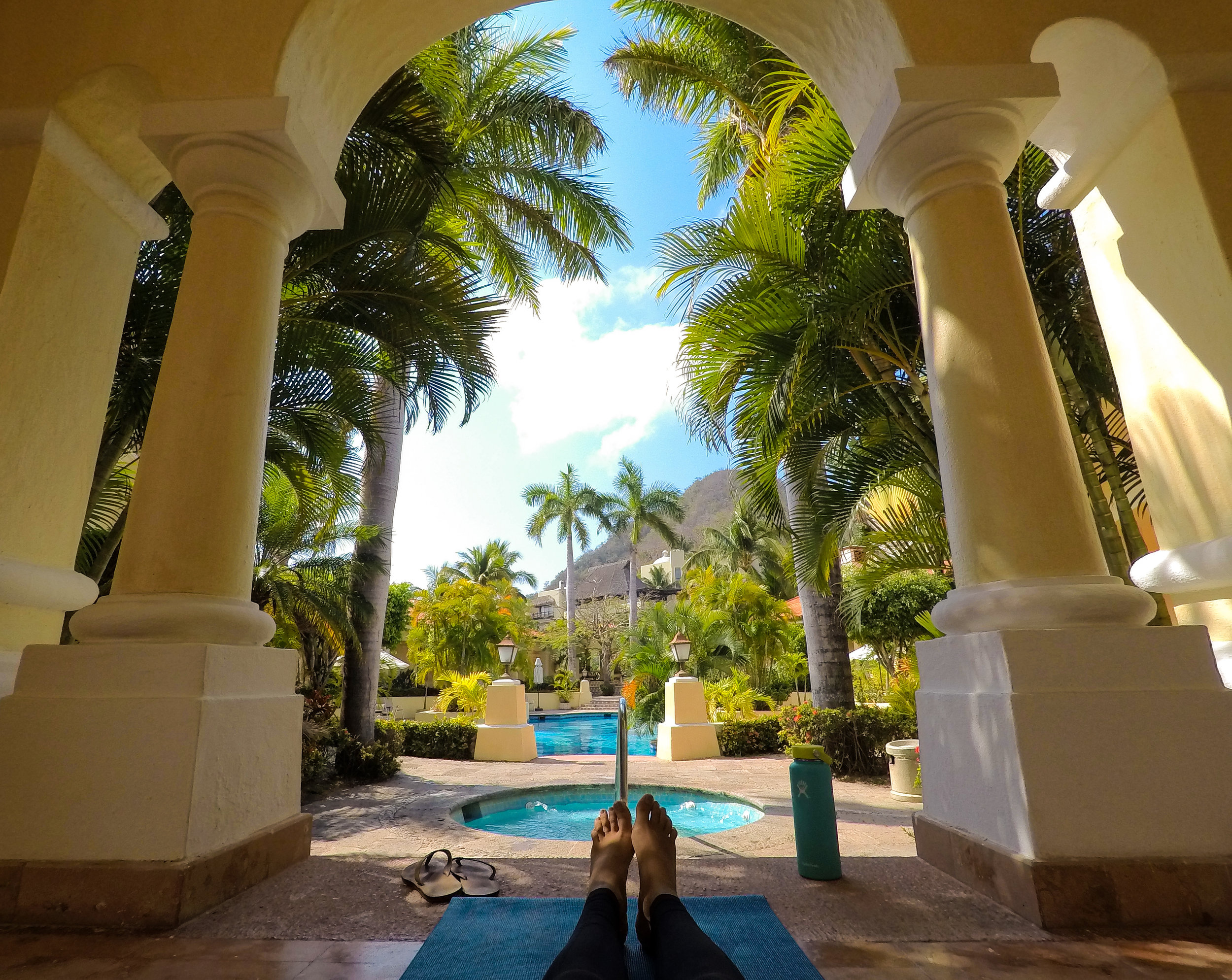 Morning yoga by the pool.