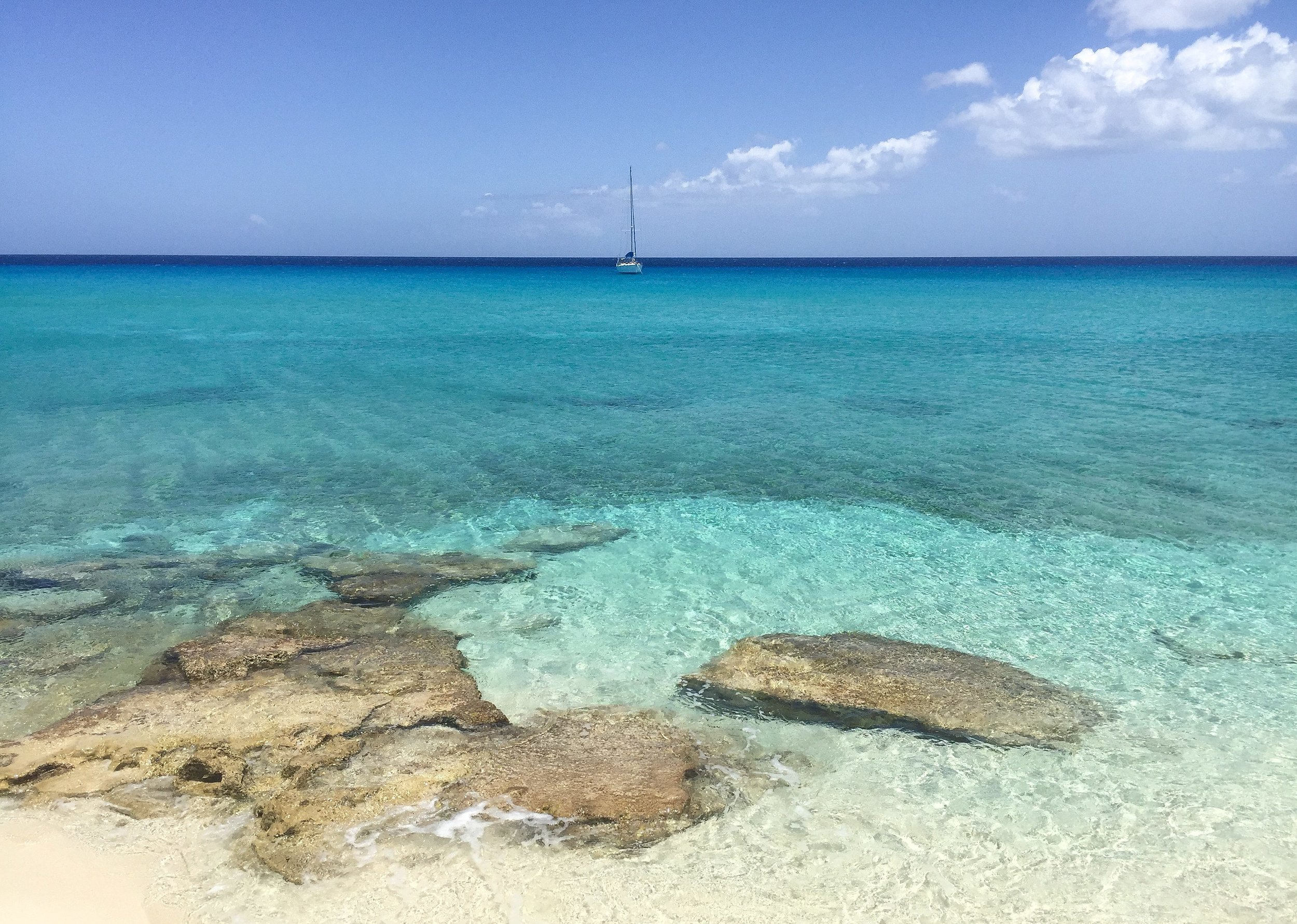 Our first view of Juniper at anchor in the Bahamas. Look at that water!