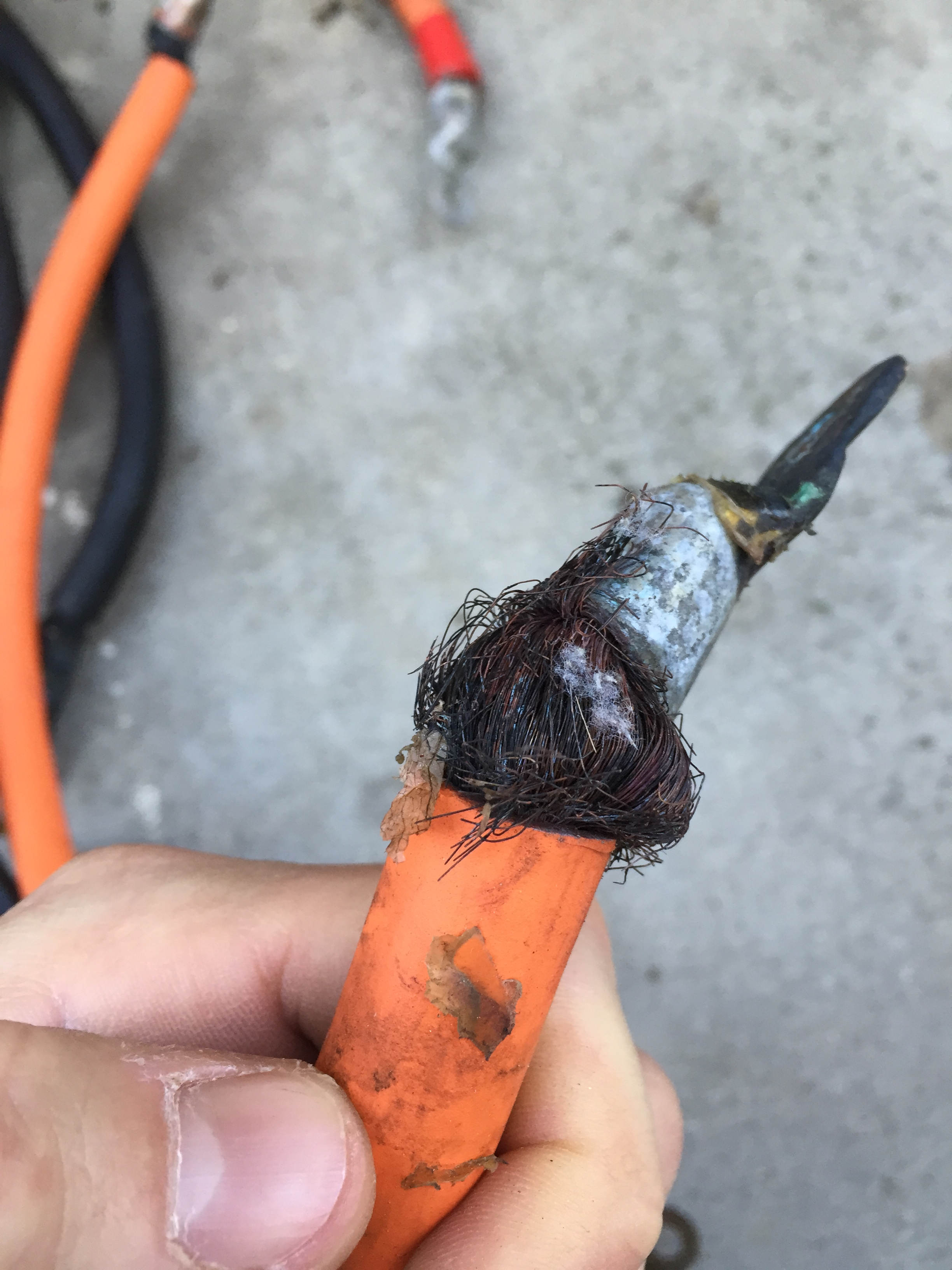 Welding cable that has been corroded and is breaking apart the outside exposed wires.