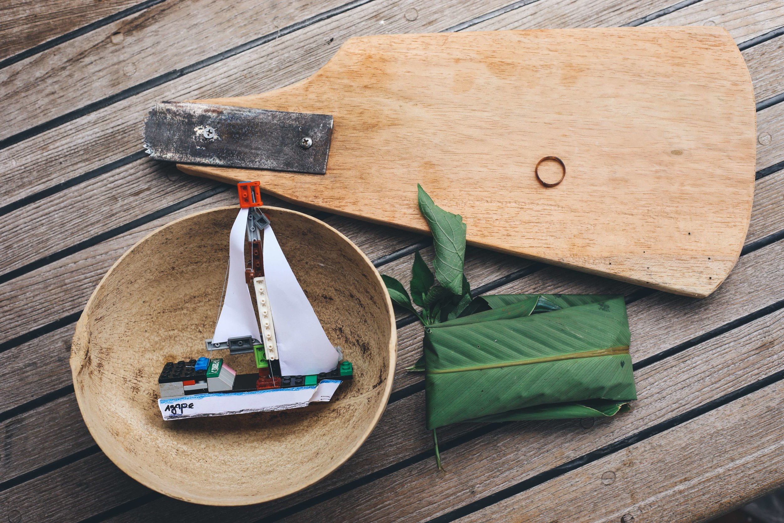 Gifts from Domingo and his family: a coconut scrapper, fresh herbs, a bowl made from a gourd they grow, a lego Agape and a ring made from a turtle shell.