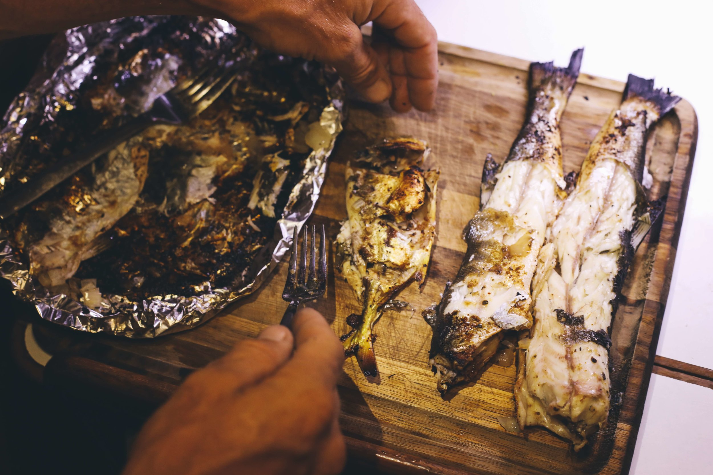 Edwin taught us how to catch these small barracuda and snapper that are abundant in the bay. As we hadn't seen a grocery store in months, this was our typical meal during our stay in Bahia Honda.