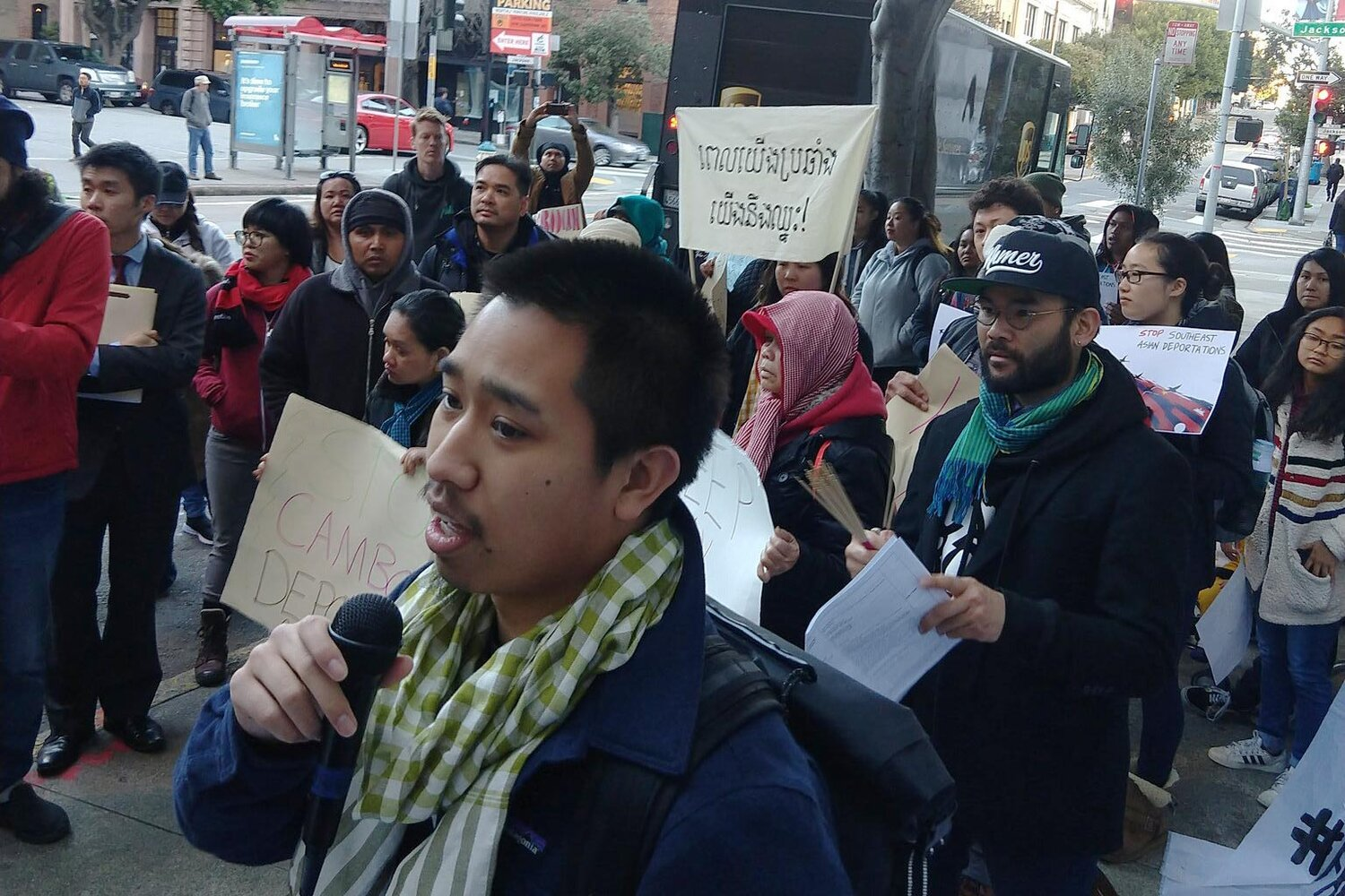 Nathaniel Tan speaking at a rally in front of San Francisco ICE building during ICE check-ins of Bay Area Cambodians.