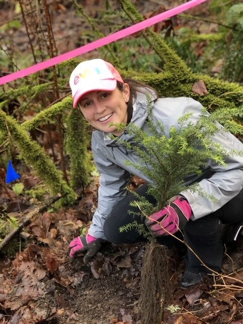Evia CEO Hilary Laney in action planting some trees