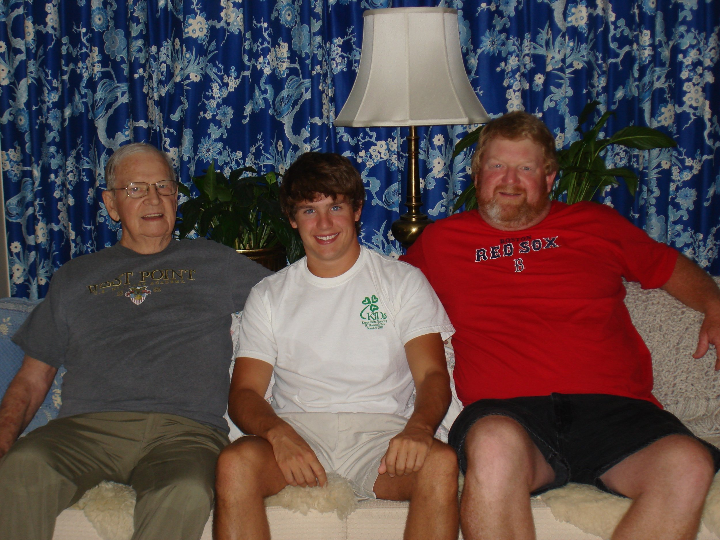 Sitting at home, proudly wearing his West Point t-shirt. Left to right: Tad's Dad, Colonel Tyler, grandson Tyler and nephew Tyler.