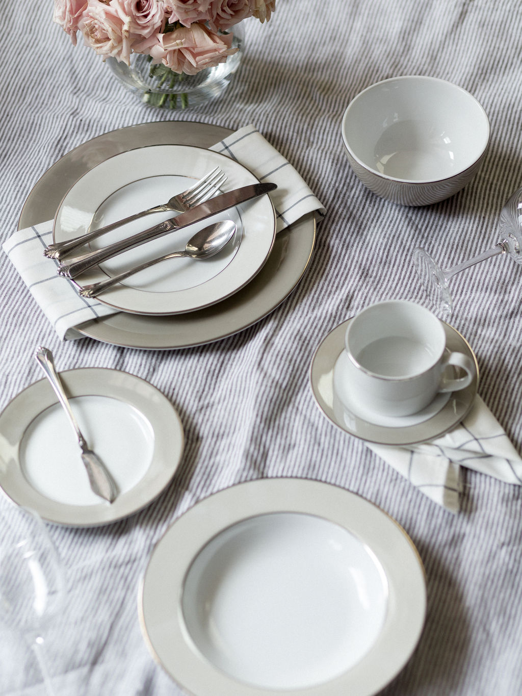 Clockwise: Dinner and Salad Plates with Dinner Fork, Knife, and Spoon; Cereal Bowl (optional); red wine glass; Coffee Cup and Saucer; Salad Bowl; White Wine Glass; Bread Plate with Butter Knife   *Dessert Plate, Water Glass, Salad Fork, Soup Spoon, and Teaspoon Not Shown