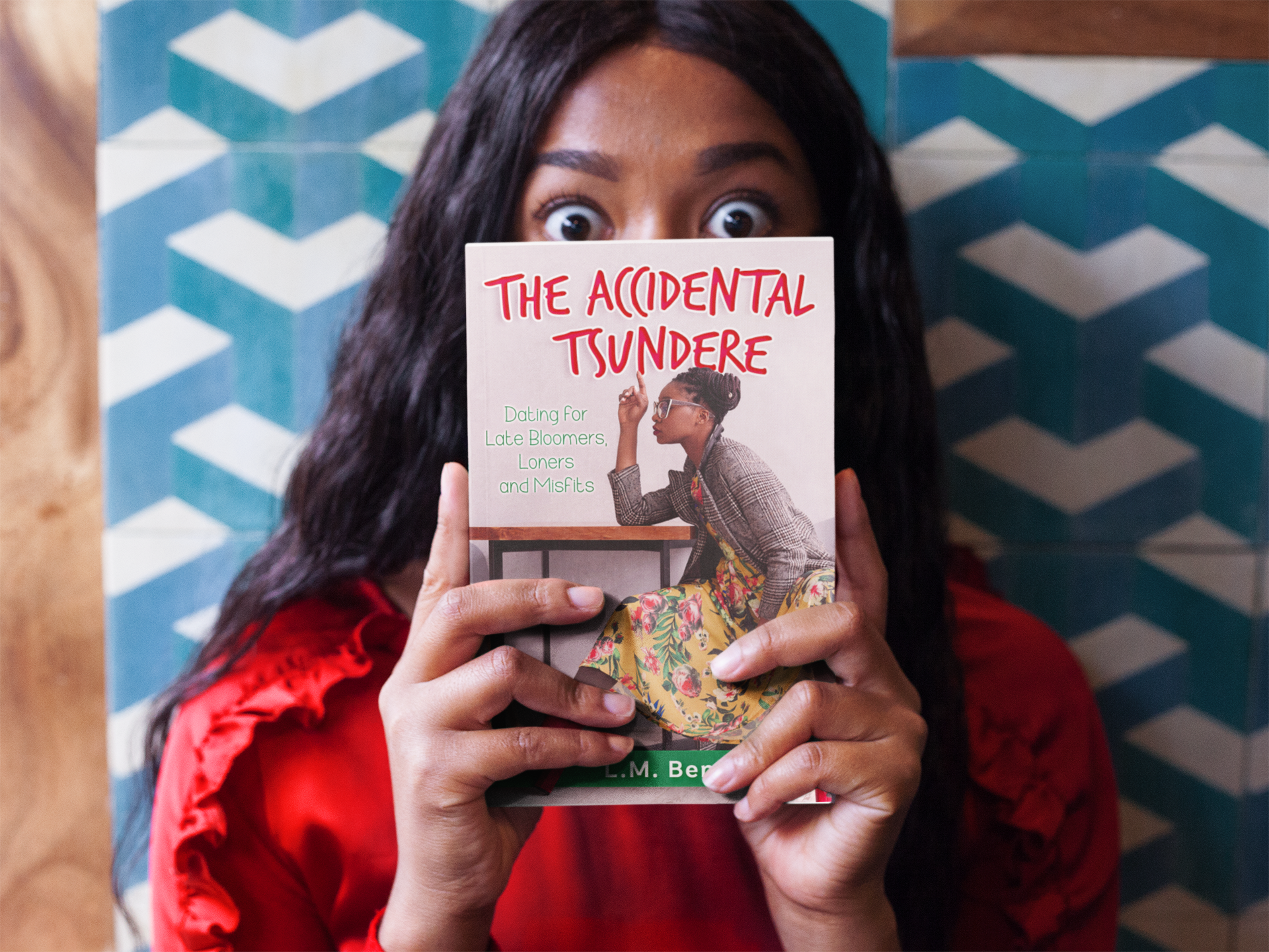 surprised-black-girl-holding-a-book-mockup-while-against-a-tiles-wall-a17345.png