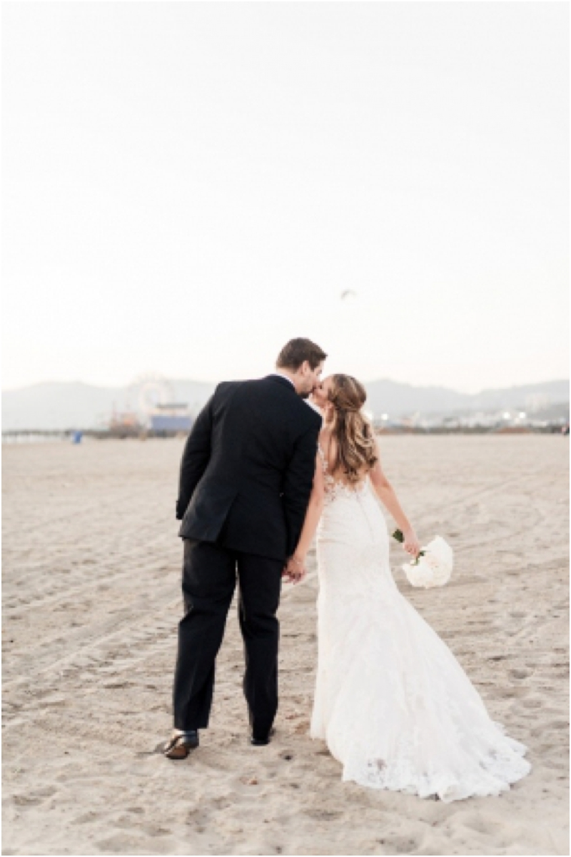 romantic portraits of bride and groom on beach in santa monica