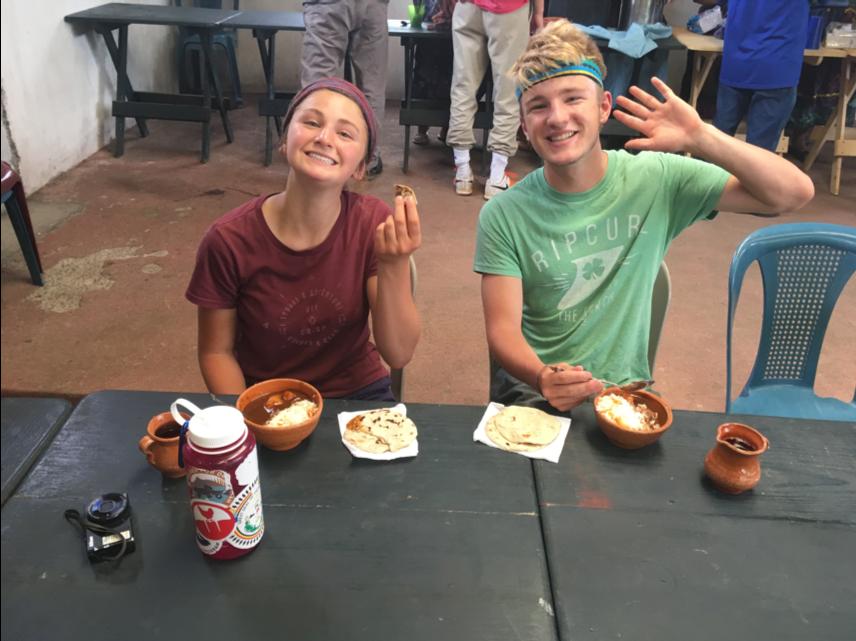 Students tasting a traditional Guatemalan dish called Pepian.