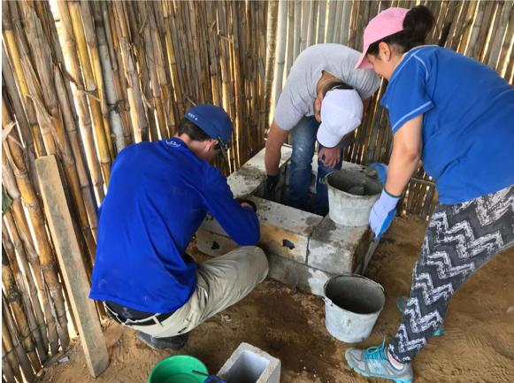 GL students from the US and Guatemala building a clean cookstove in Segunda Cruz, Guatemala