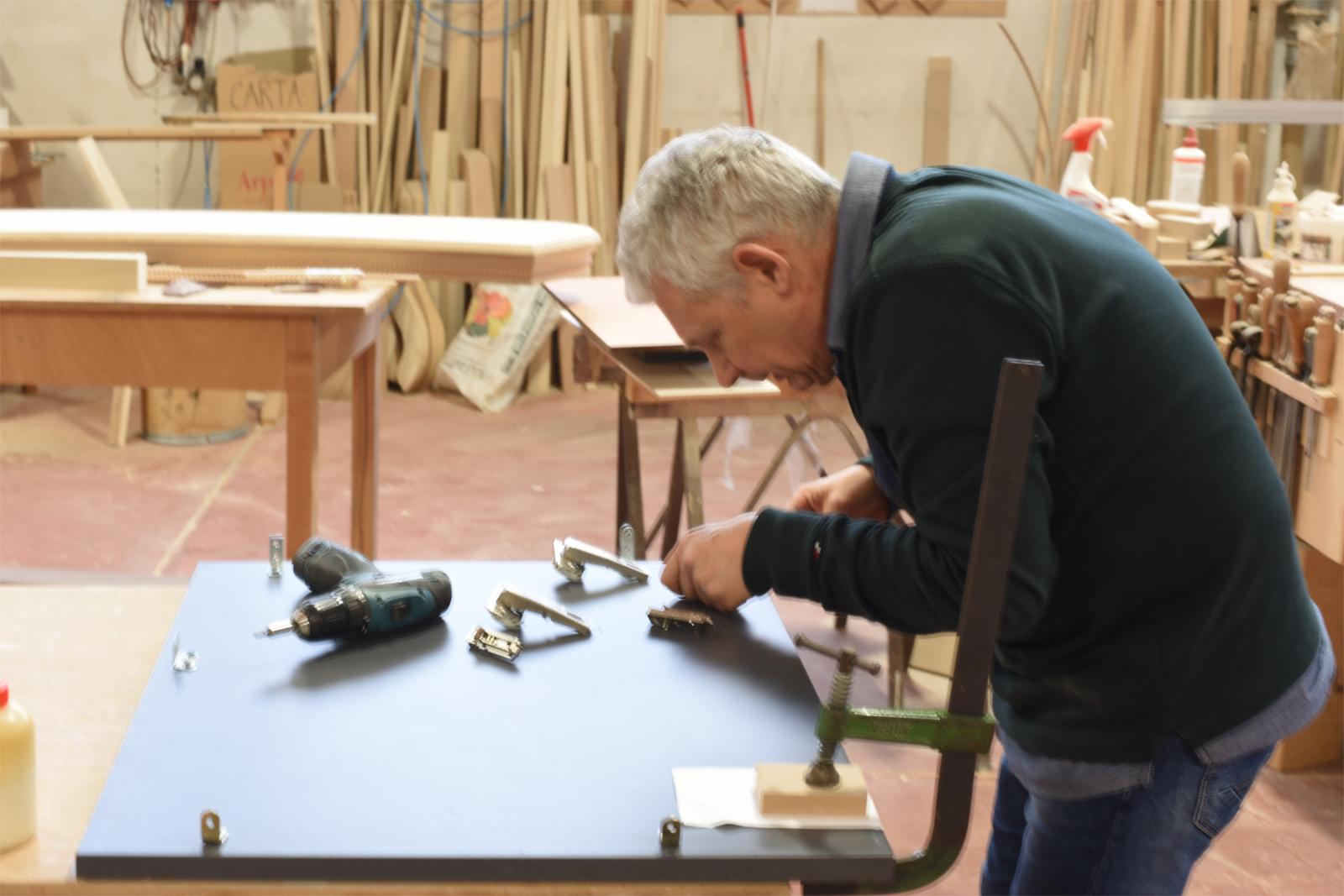 Craftsman at work on a millwork piece.