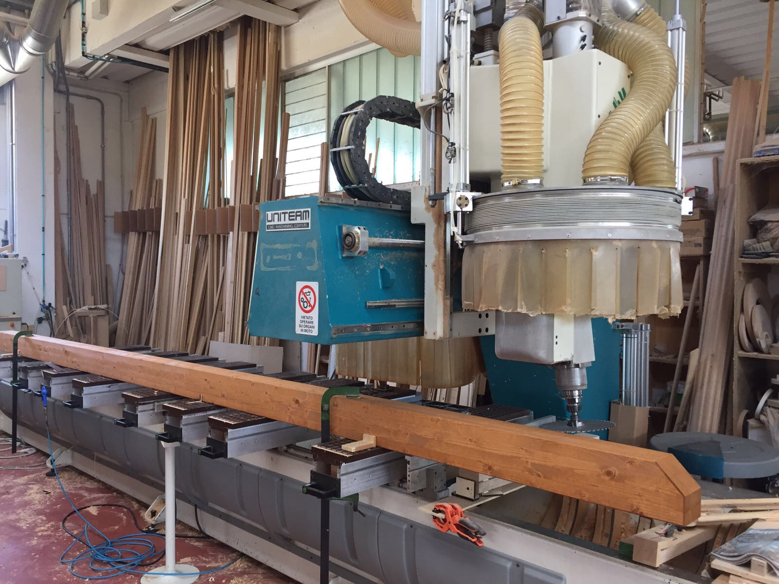 Customizing a beam with a 5-axis CNC cutter.
