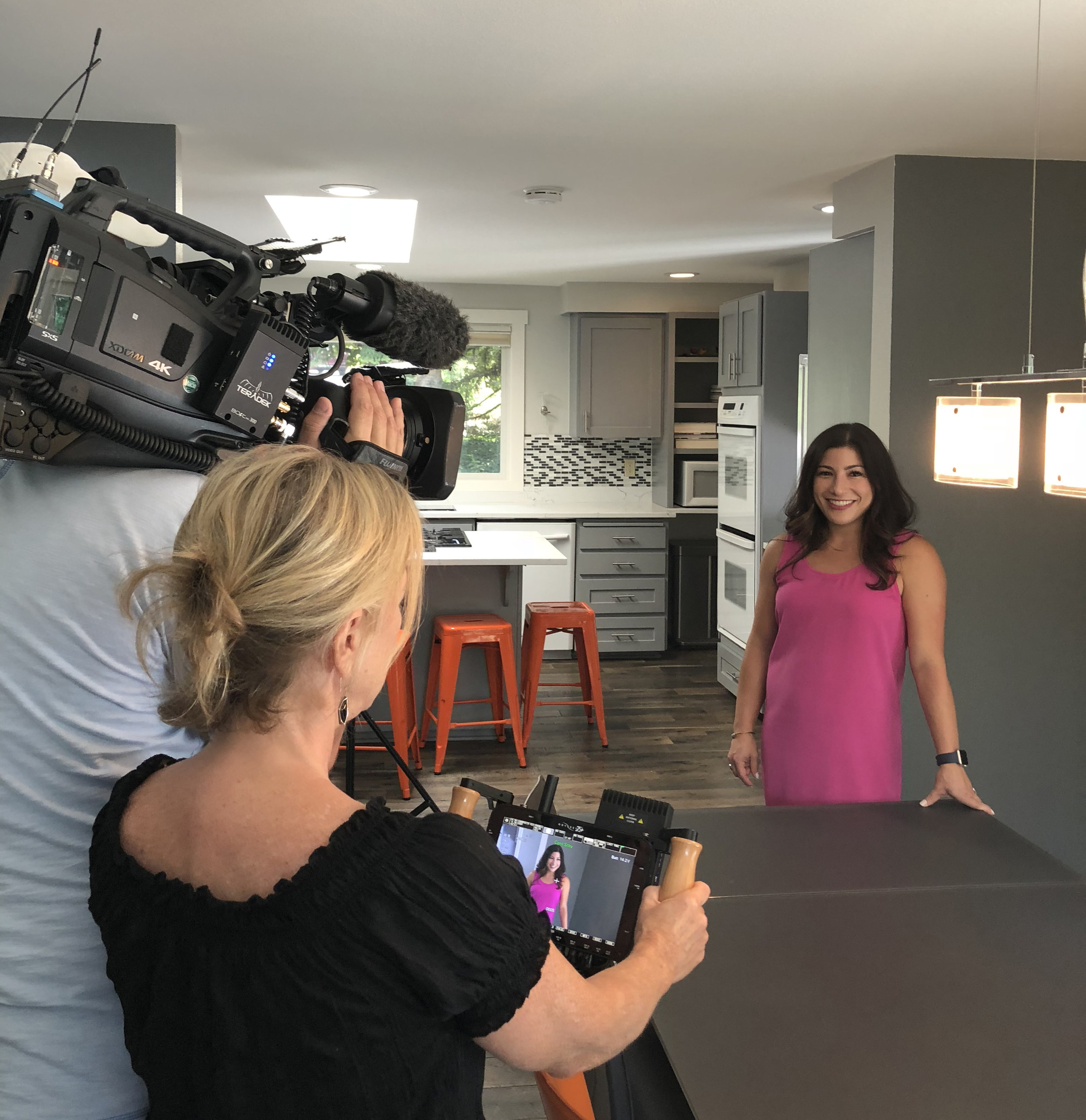 Hass was all smiles as she filmed an interview segment at House Number Two.