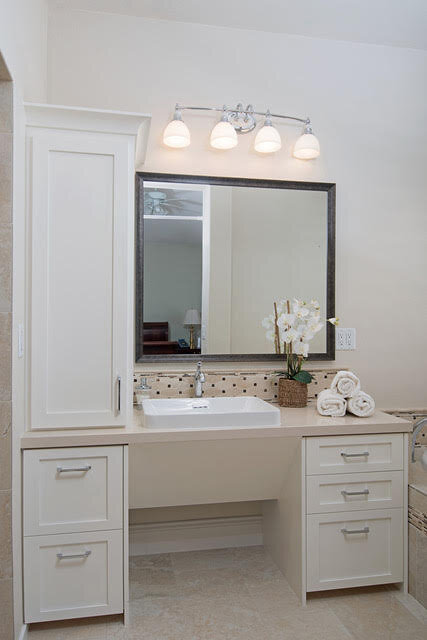 After: …to bright and spacious. Our custom roll up vanity provides our client who uses a scooter ready access to everything she needs at the vanity.