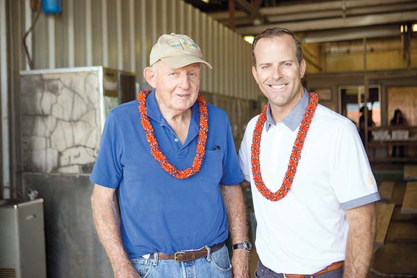 Ulupalakua Ranch's Pardee Erdman, one of the former owner investors of Maui Gold Pineapple Co., stands with Joe LeVecke, president of Maui Gold Pineapple Co. and Hali'imaile Distilling Co.