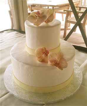 Package #1 | Serves 35   Includes: 1 Flavor choice. Fresh flower decor*, Local setup & delivery**   French Buttercream:   Cost $227.50  Fondant, Marzipan, White Chocolate:  Cost $227.50