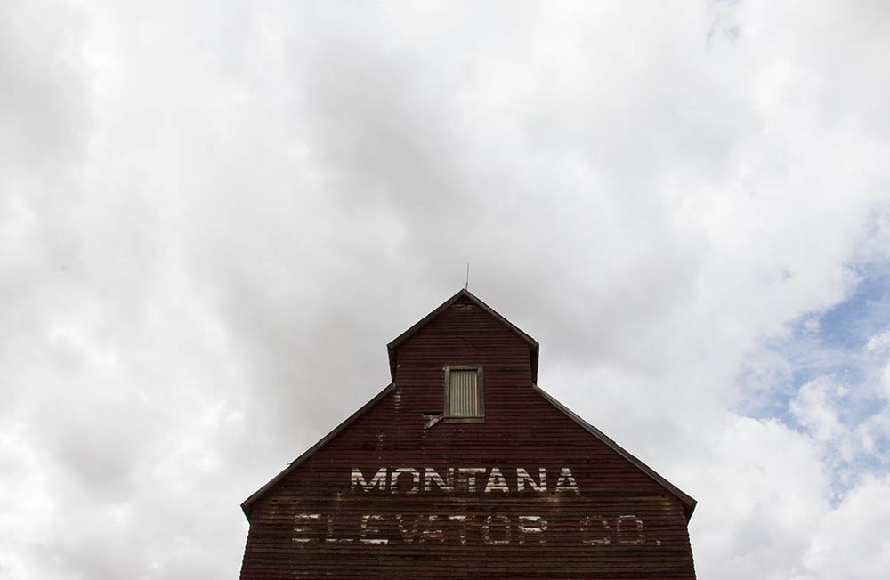 An abandoned grain elevator in downtown Grass Range, Montana.