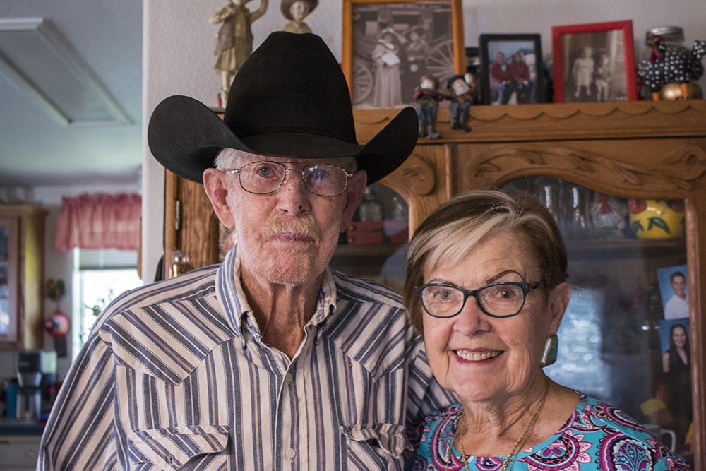 Mabel and Grant Dobbs stand inside their home in Weiser, Idaho.