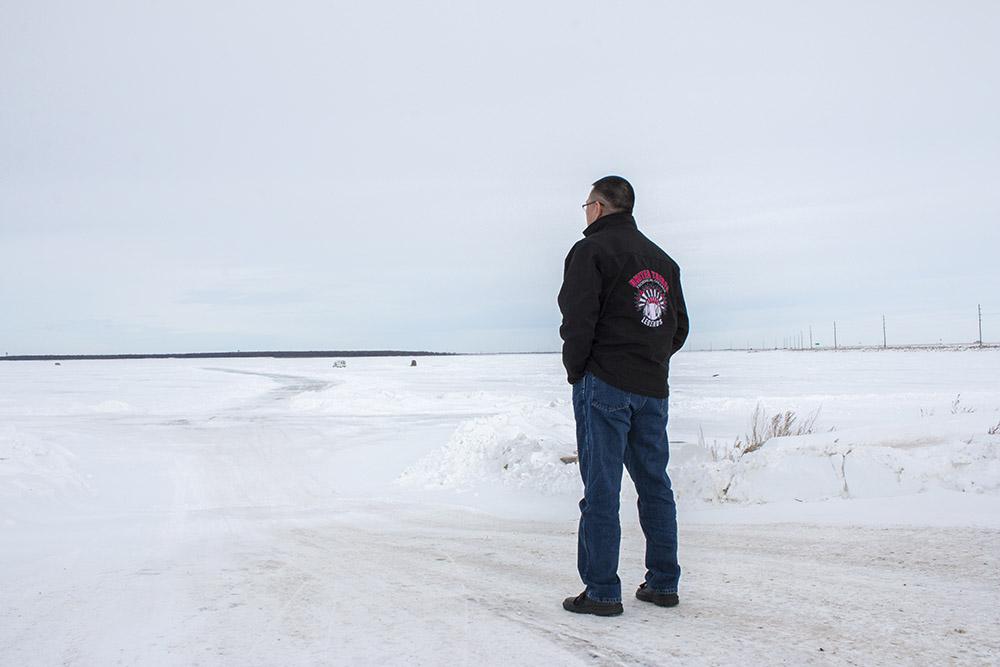 Doug looks out across the frozen lake.