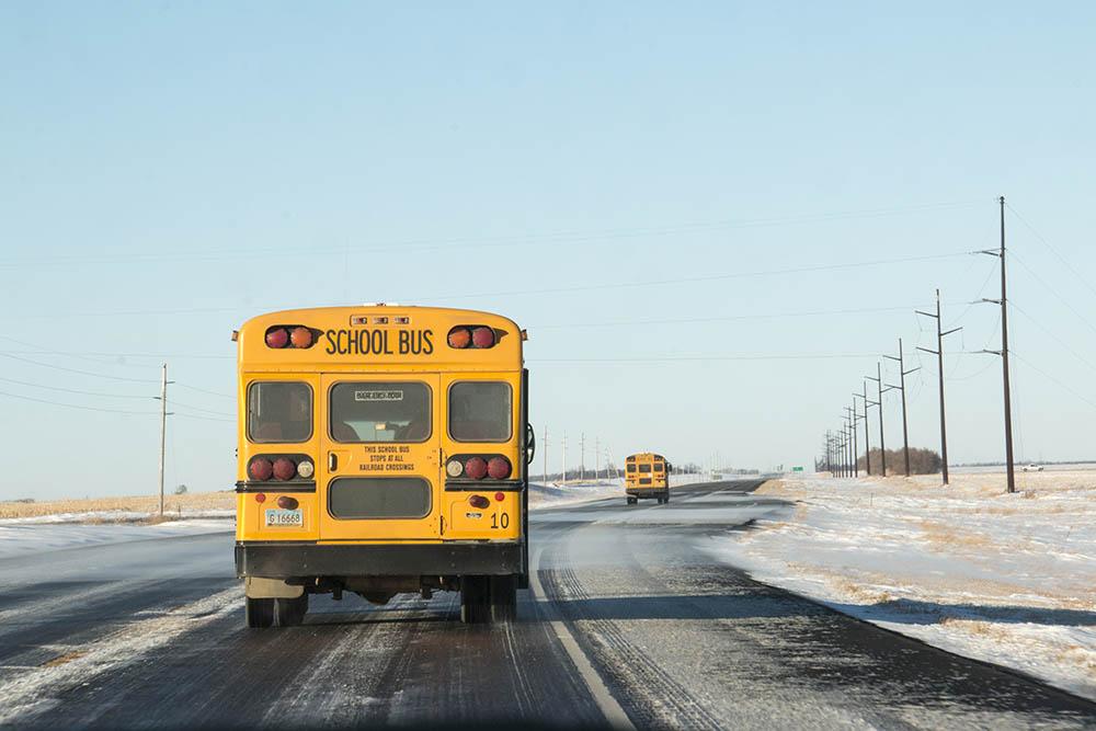 School busses taking children home on Spirit Lake Nation.