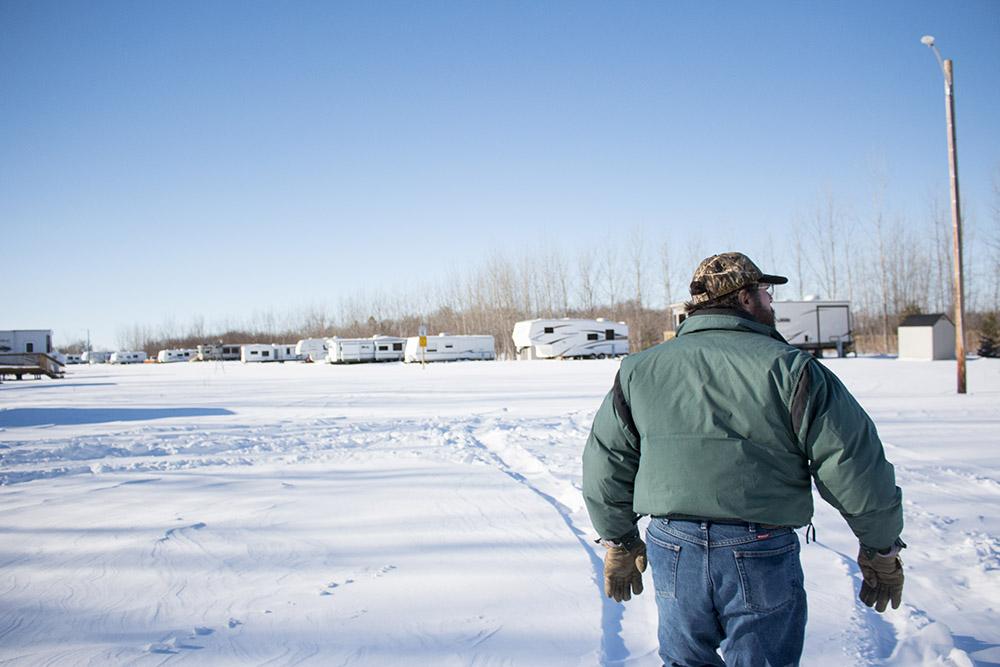 Rick walking through Six Mile Bay campground.