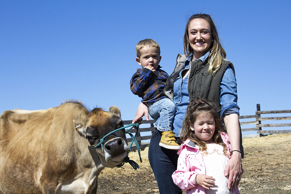 Annika Charter-Williams holds her son, Willie, and daughter, Stevie at their ranch in Shepherd, Montana.