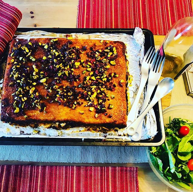 """If you're from a rice culture like me, you'll appreciate another way to eat crispy rice with the Persian dish Tahchin Morgh - a baked saffron yogurt rice stuffed with chicken. Thanks @saveurmag for the recipe. Topped with buttery cranberries and pistachios it was salty-sweet magic. Stay tuned for an upcoming Our Edible Stories podcast episode with Spanish-Iranian food explorer @sarita.akhavan """"The Girl with the Pomegranate Tattoo"""" -coming this month! Ourediblestories.com"""
