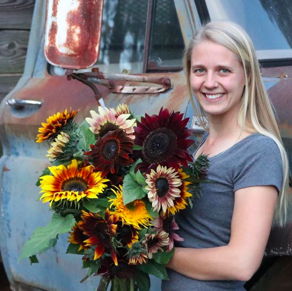 PRessLY Williams holding renfrow farms' beautiful sunflower blooms