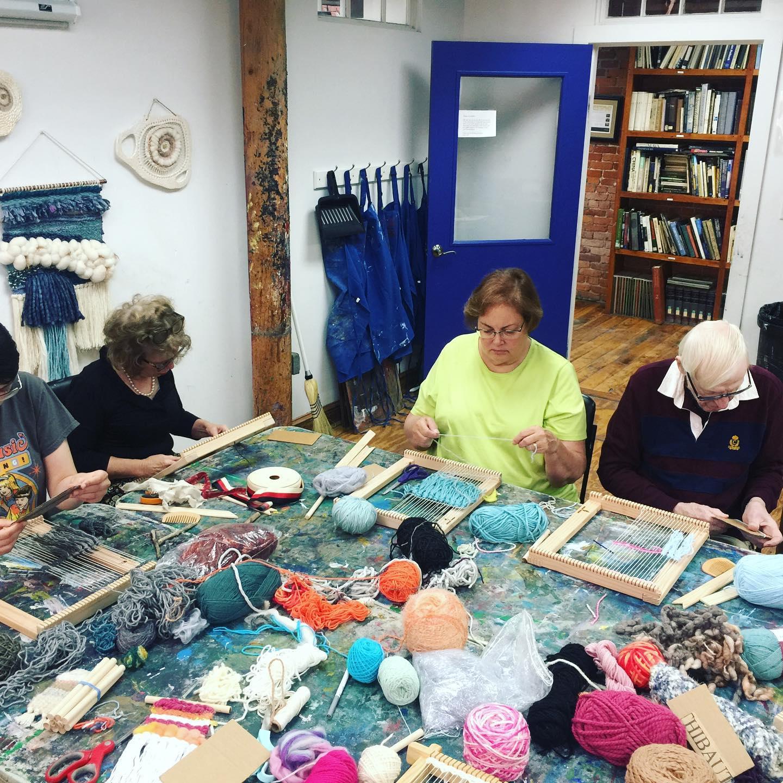 adult weaving group sitting.jpg